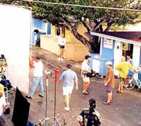 film crew surrounds veggie stand at Harbour Island Bahamas